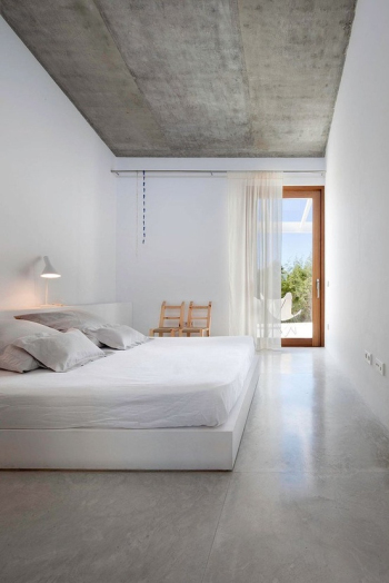 Spacious and bright white bedroom