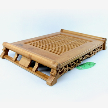Dual bamboo tea tray filled with water drainage